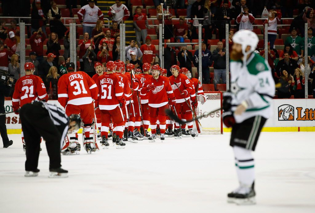 DETROIT, MI - NOVEMBER 29:  The Detroit Red Wings celebrate a 3-1 victory behind Jordie Benn #24 of the Dallas Stars at Joe Louis Arena on November 29, 2016 in Detroit, Michigan.  (Photo by Gregory Shamus/Getty Images)