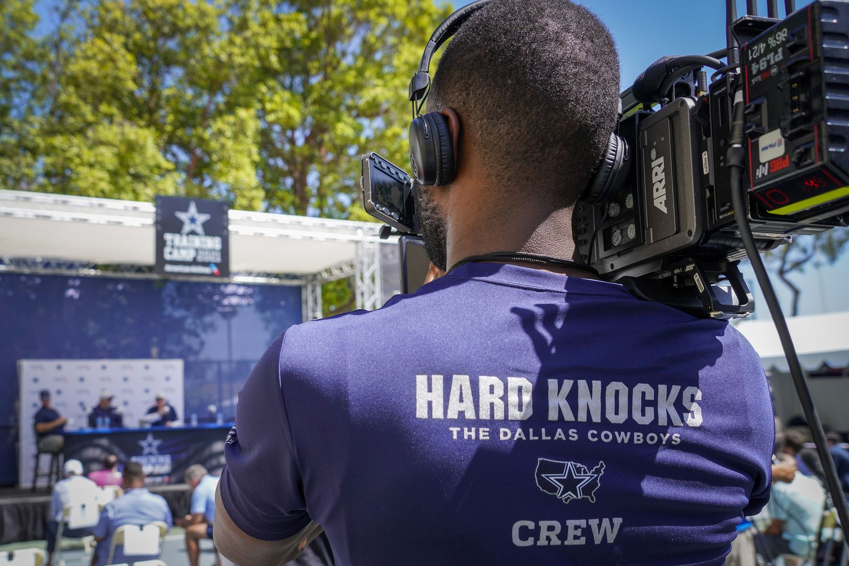 A HBO Hard Knocks crew records the opening news conference for the Dallas Cowboys training camp on Wednesday, July 21, 2021, in Oxnard, Calif.