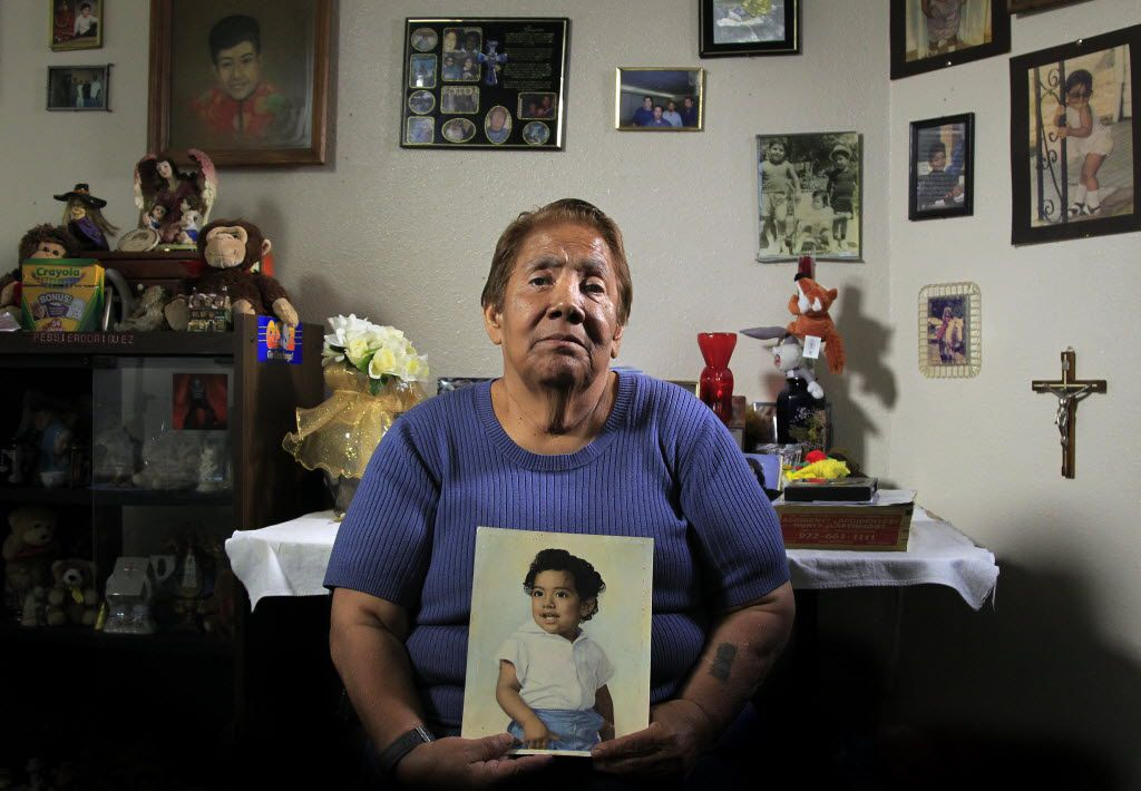 Bessie Rodriguez, the mother of Santos Rodriguez, holds a painting of her son in her Dallas home in this photo taken 40 years after the 12-year-old boy was shot to death by a Dallas police officer.