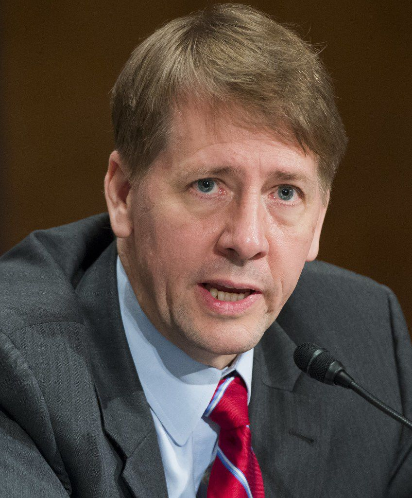 Richard Cordray was appointed director of the Consumer Financial Protection Bureau in January 2012. The bureau is credited with returning $12 billion to more than 29 million consumers due to fraudulent financial deals. (File photo, 2016/Getty Images)