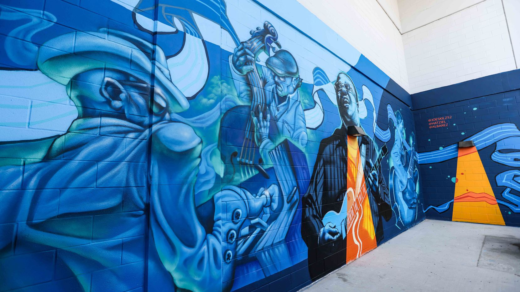 Ten 16-foot-high murals color the back of The Stack building in Deep Ellum as part of Blues Alley.