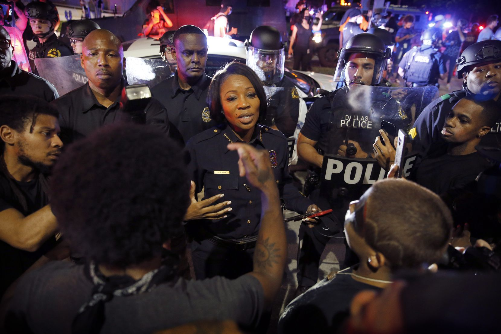 Dallas Police Chief U. Reneé Hall confronted protesters at Young Street and South Griffin Street in downtown Dallas during a May 29 demonstration. Police tactical officers had fired tear gas at protesters in an earlier encounter.