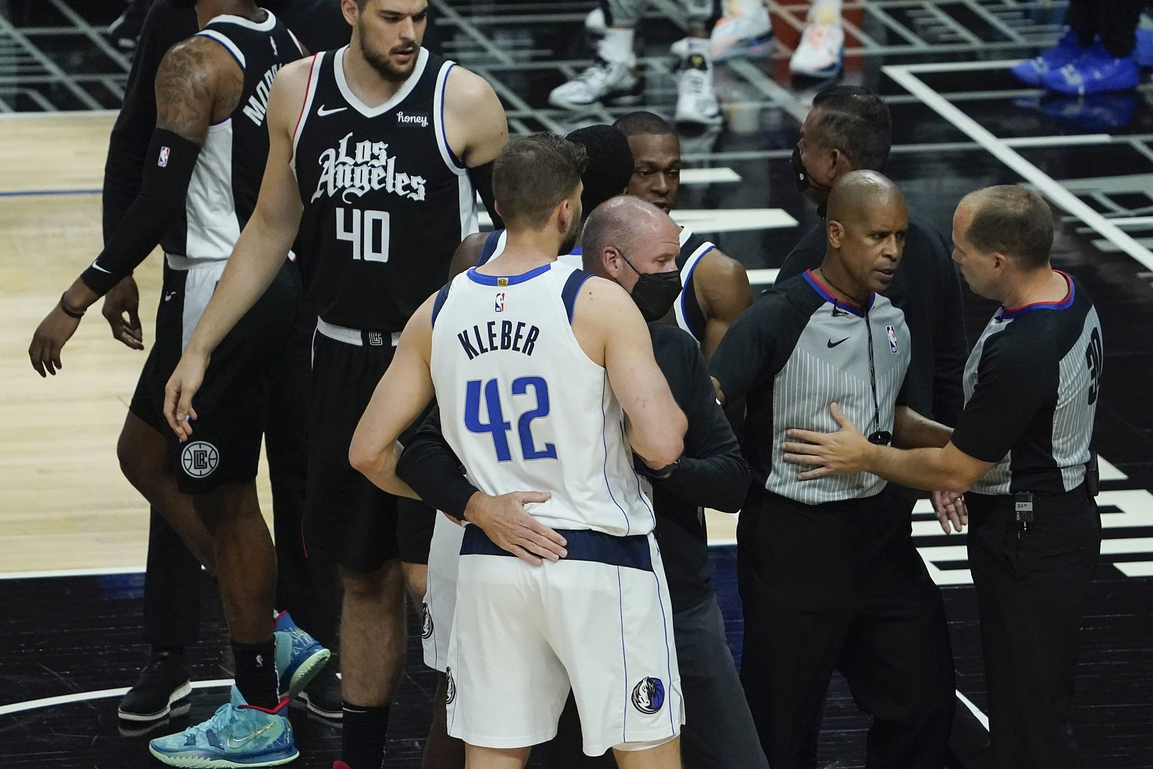 Officials separate Dallas Mavericks forward Maxi Kleber from LA Clippers forward Marcus Morris Sr. during the first quarter of an NBA playoff basketball game at the Staples Center on Wednesday, June 2, 2021, in Los Angeles.  (Smiley N. Pool/The Dallas Morning News)