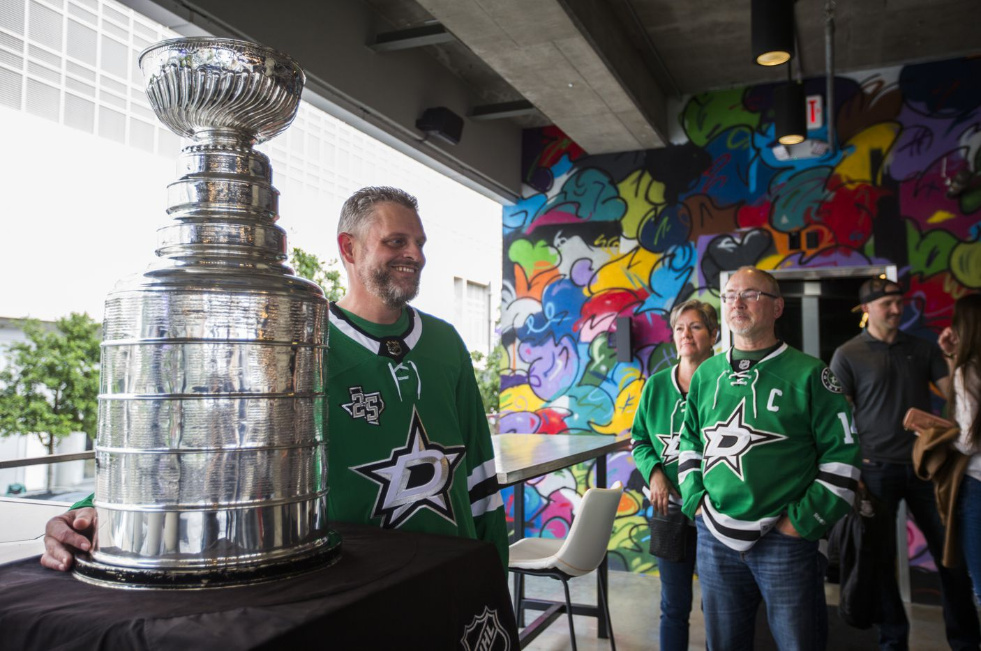 Brad Gilbow poses for a photo with the Stanley Cup at DIBS on VICTORY before Game 6 of the Stars-Predators series.