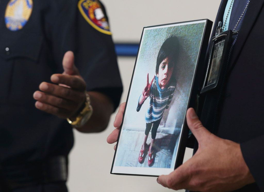 """Galveston Police Detective Jeff Banks holds a photo of Jayden Alexander Lopez, the 4-year-old boy known as """"Little Jacob"""" after his body was found on a Galveston beach last fall. Two Houston women have been arrested and charged with crimes in connection to the investigation."""