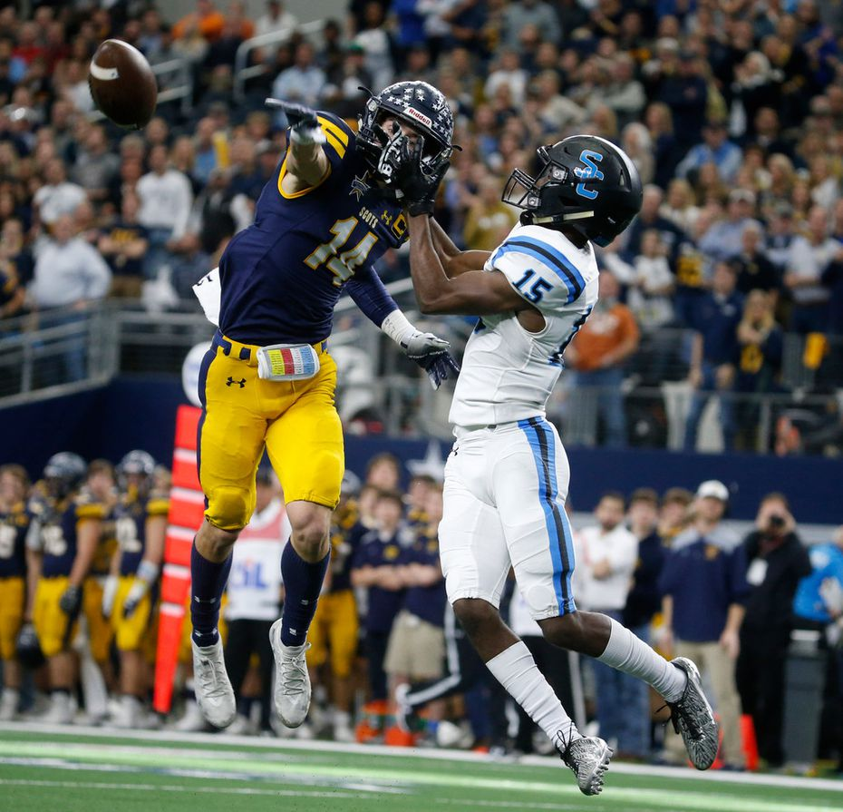 Highland Park's  Hudson Clark (14) breaks up a pass intended for Shadow Creek's Jared Jackson (15) during the first half of the Class 5A Division I football state championship game at AT&T Stadium in Arlington, Texas on Dec 22, 2018.