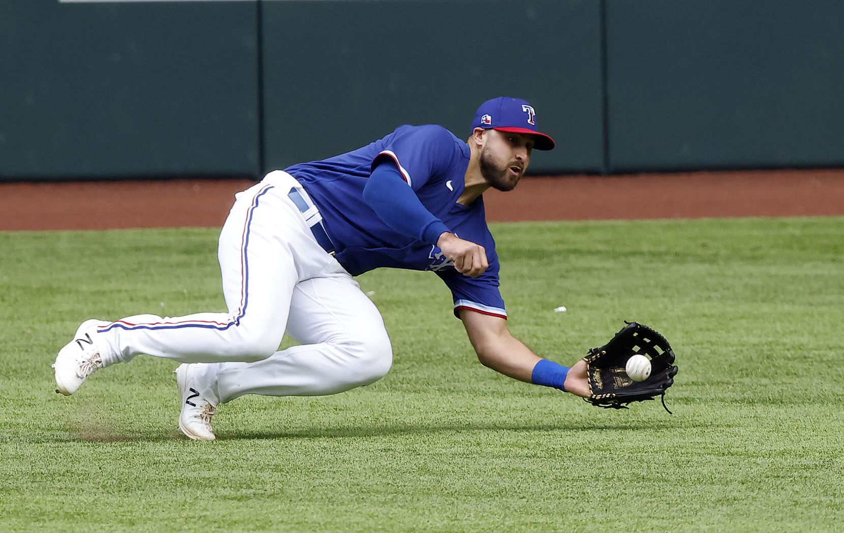 Texas Rangers center fielder Joey Gallo (13) makes a highlight catch making the fly out of Milwaukee Brewers batter Jackie Bradley, Jr. in the third inning at Globe Life Field in Arlington, Texas. The teams were playing in an exhibition game, Tuesday, March 30, 2021. (Tom Fox/The Dallas Morning News)