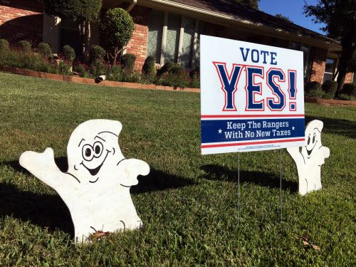 Halloween decorations adorn a Vote Yes sign in the front yard of a North Arlington home. The Vote Yes! camp is trying to get voters to approve a new $1 billion ballpark with half of the funding coming from Arlington taxpayers.