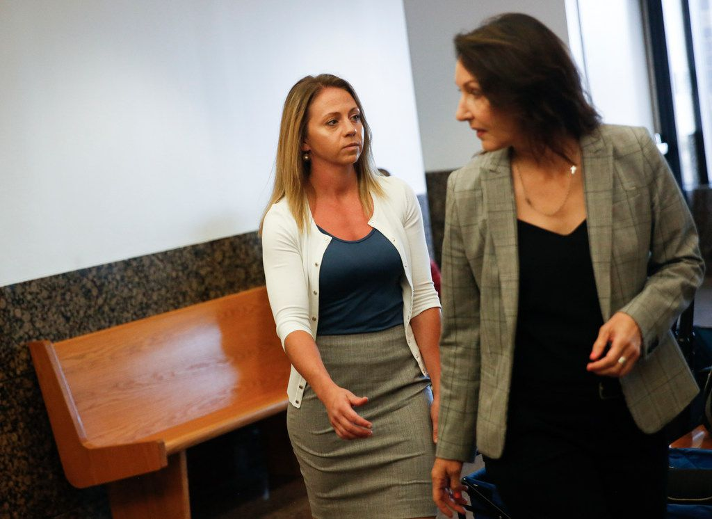 Former Dallas police Officer Amber Guyger (left) enters the 204th District Court in the Frank Crowley Courts Building for a pretrial hearing on Monday, Aug. 19, 2019, in Dallas. Guyger is to go on trial Sept. 23 in the killing of Botham Jean.