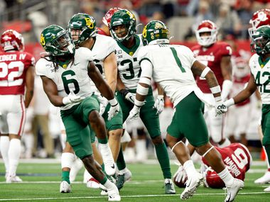 Baylor Bears running back JaMycal Hasty (6) celebrates the Bears stop of Oklahoma Sooners returnerTre Brown (6) i the second quarter of the Big 12 Championship at AT&T Stadium in Arlington, Saturday, December 7, 2019.