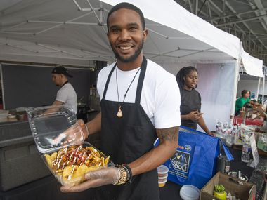 Brandon Waller, owner of Bam's Vegan, at his food stand in the Dallas Farmers Market on June 2, 2019. (Robert W. Hart/Special Contributor)