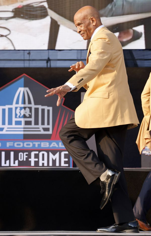 Pro Football Hall of Fame inductee Drew Pearson of the Dallas Cowboys strikes a pose onstage during the Class of 2021 enshrinement ceremony at Tom Benson Hall of Fame Stadium in Canton, Ohio, Sunday, August 8, 2021. (Tom Fox/The Dallas Morning News)