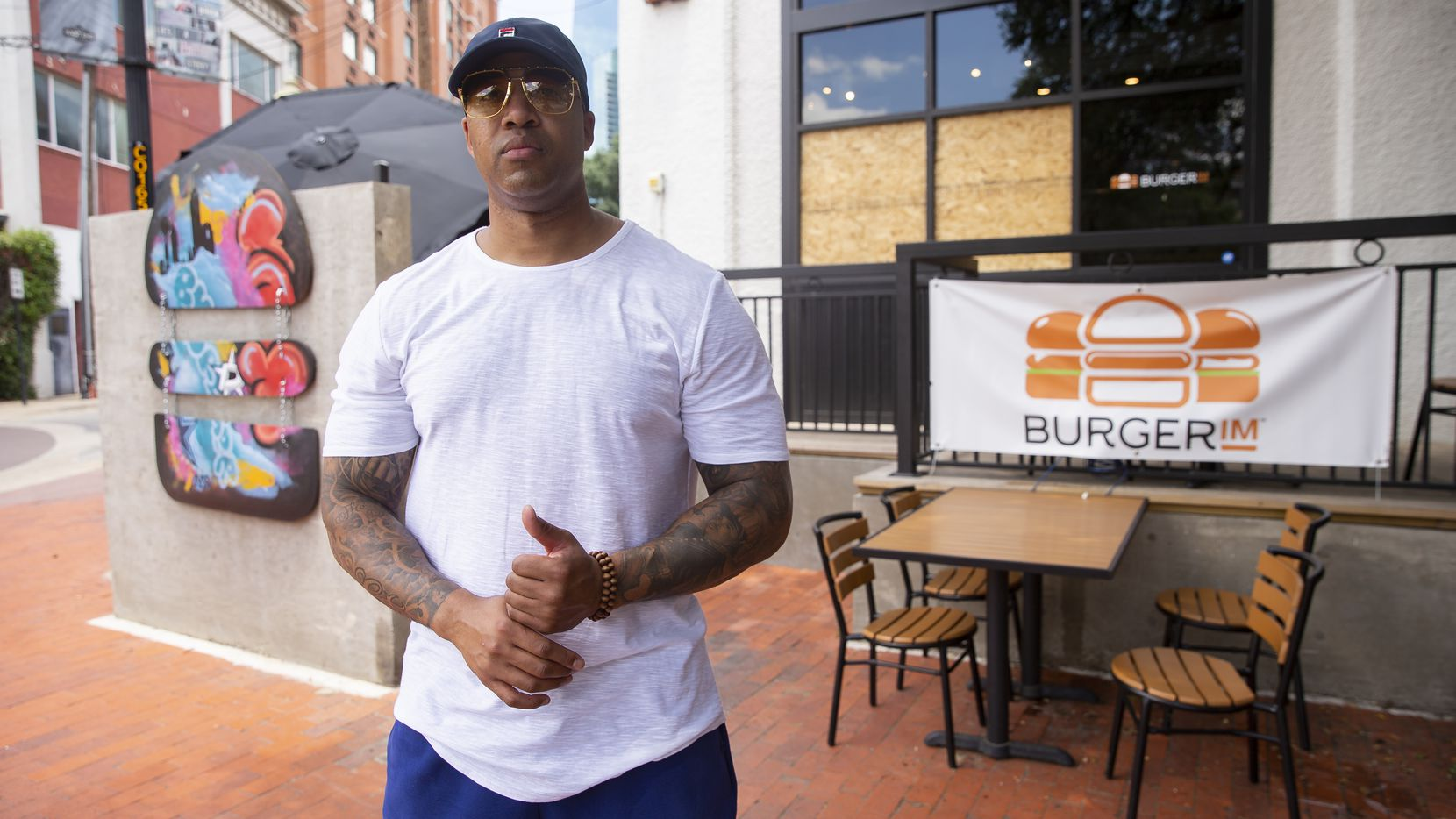 Owner Wes Williams stands outside of BurgerIM on Sunday morning, May 31, 2020 in Dallas. Many in the community have shown up to support the West End restaurant after it was damaged by protesters Friday night. (Juan Figueroa/ The Dallas Morning News)