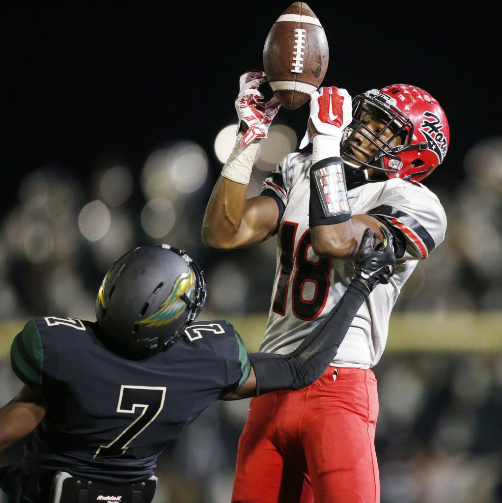 Cedar Hill wide receiver Damarkus Lodge (18) catches a pass for a touchdown in the first quarter to make the score 13-6 during a high school football game between Cedar Hill and DeSoto at Eagle Stadium in DeSoto, Texas Thursday October 23, 2014. (Andy Jacobsohn/The Dallas Morning News) 10242014xSPORTS