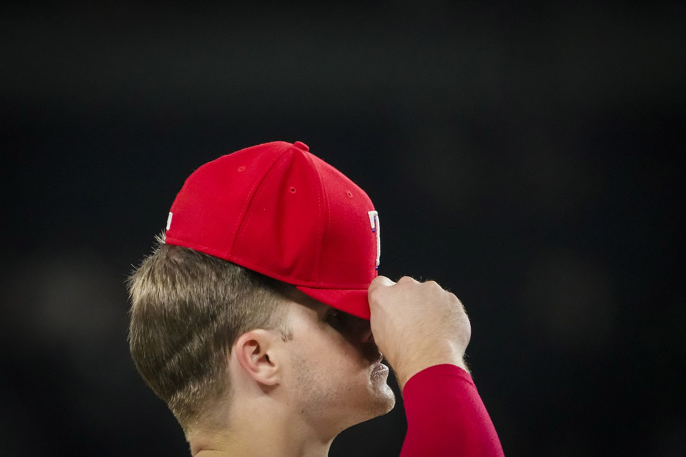 Texas Rangers third baseman Brock Holt adjusts his cap during the eighth inning against the Detroit Tigers at Globe Life Field on Tuesday, July 6, 2021.