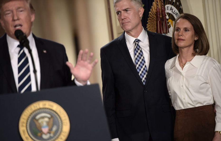 Judge Neil Gorsuch (C) and his wife Marie Louise look on, after US President Donald Trump nominated him for the Supreme Court, at the White House in Washington, DC, on January 31, 2017. President Donald Trump nominated federal appellate judge Neil Gorsuch as his Supreme Court nominee, tilting the balance of the court back in the conservatives' favor. / AFP PHOTO / Brendan SMIALOWSKIBRENDAN SMIALOWSKI/AFP/Getty Images