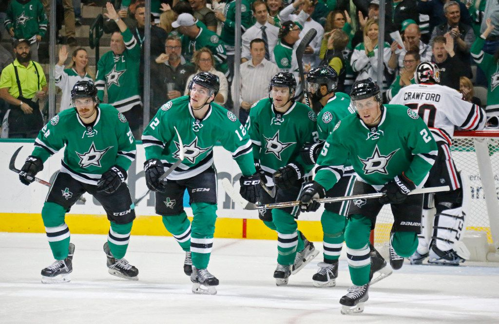 Dallas Stars Stephen Johns (28), Radek Faksa (12),  Antoine Roussel (21), Johnny Oduya (47) and Brett Ritchie (25) skate away after scoring the Stars first goal against Chicago Blackhawks goalie Corey Crawford (50) in the first period during the Chicago Blackhawks vs. the Dallas Stars NHL hockey game at the American Airlines Center in Dallas on Saturday, November 5, 2016. (Louis DeLuca/The Dallas Morning News)