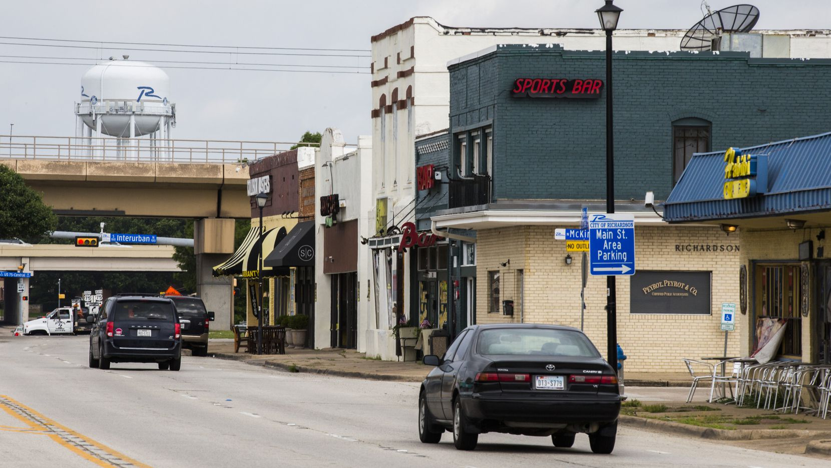 Vehicles drive through the 100 block of East Main Street in old downtown Richardson, an area set for redevelopment.