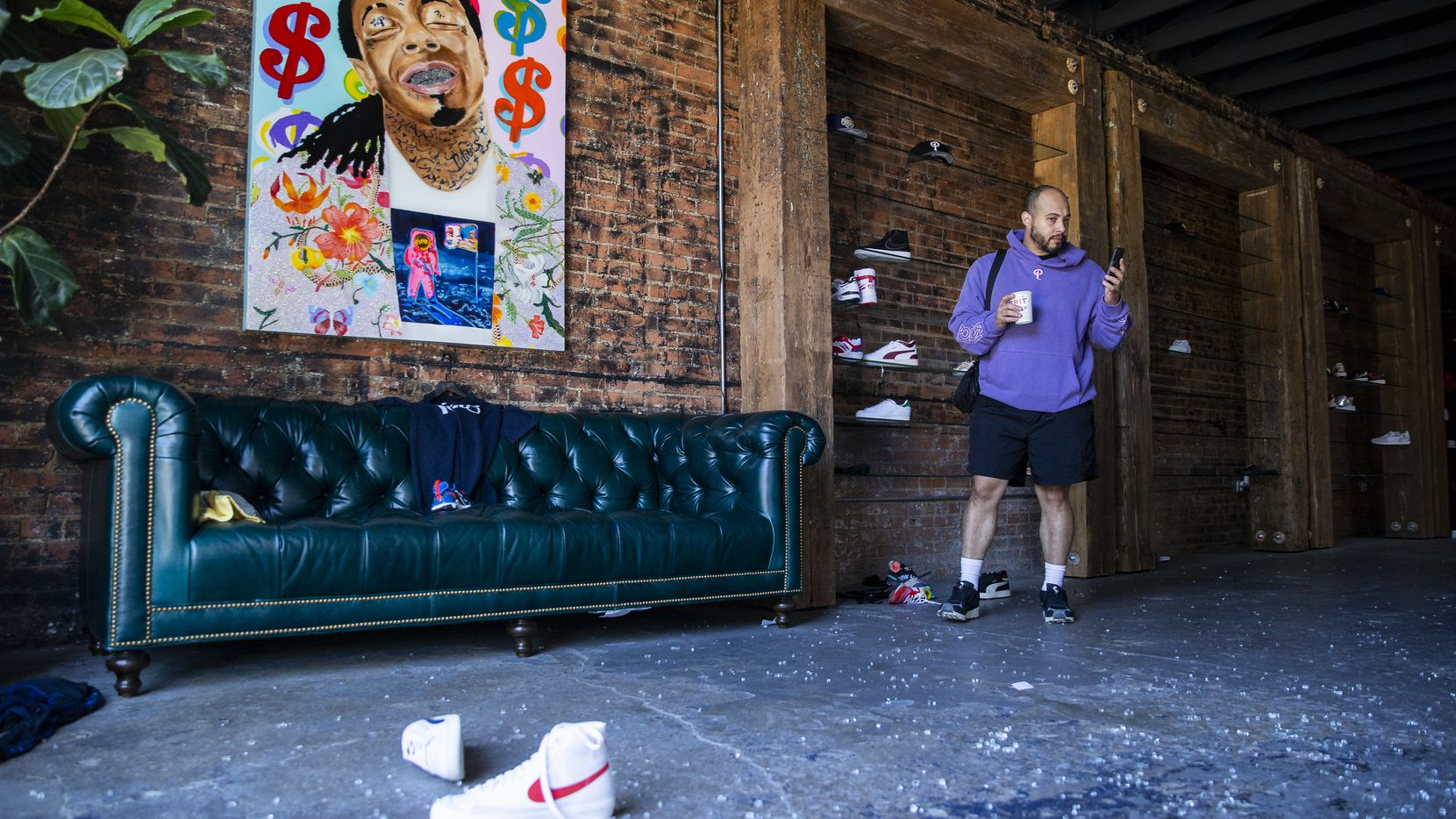Sneaker Politics manager Kellen Daniel videos the damage done to the shop after it was looted during Friday night protests.