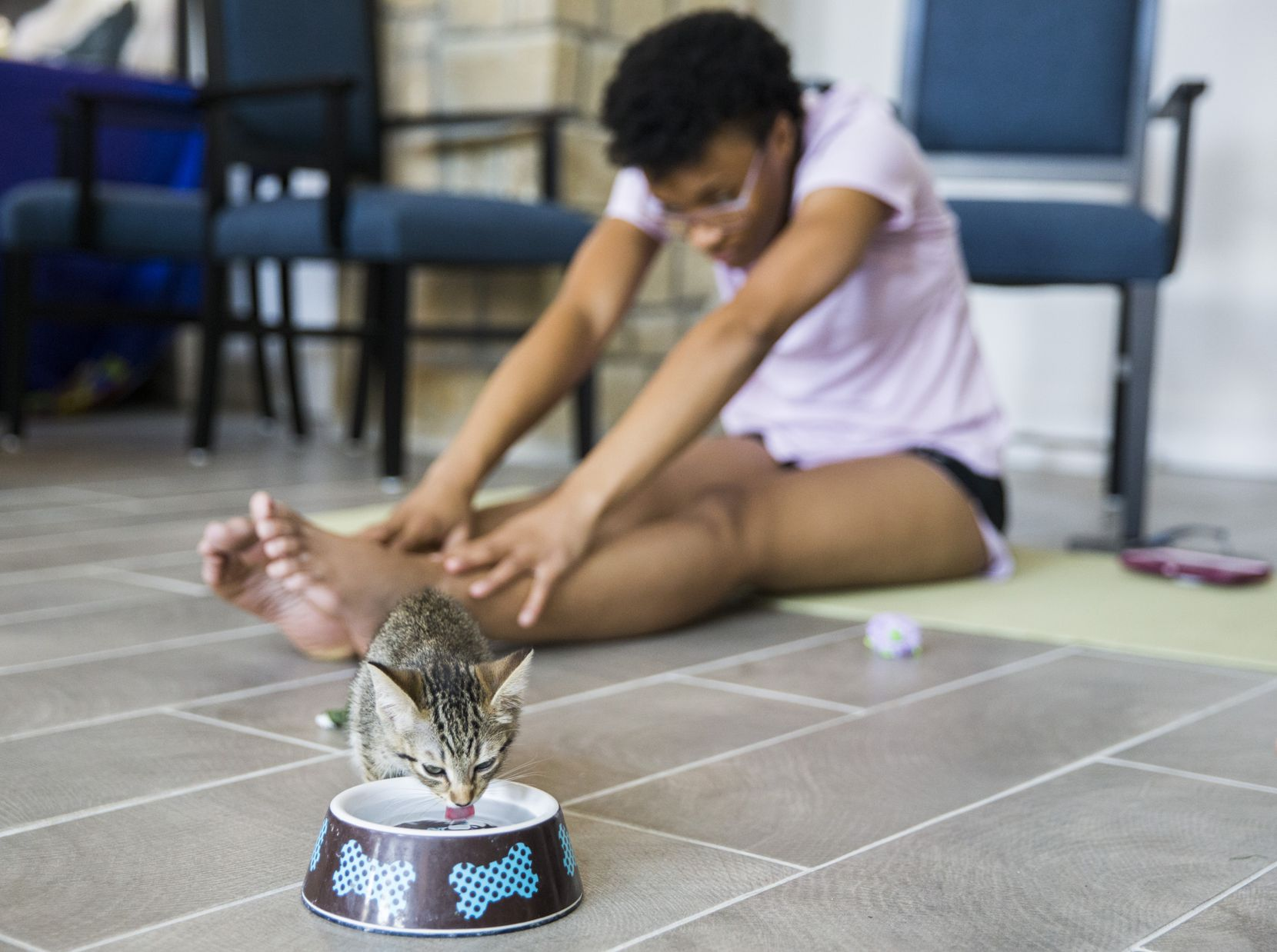 A kitten took a sip of water near Keeiona Burnett during a yoga class hosted by Attiva Central Park and Prairie Paws on Thursday, June 20, 2019, at Attiva Central Park in Grand Prairie.