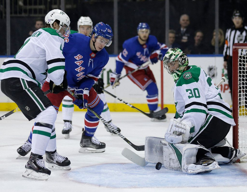 Dallas Stars goaltender Ben Bishop, right, makes a save during the second period of an NHL hockey game against the New York Rangers, Monday, Nov. 19, 2018, in New York. (AP Photo/Seth Wenig)