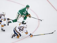 Dallas Stars center Jason Dickinson (18) makes a break past Nashville Predators defenseman Dante Fabbro (57) and defenseman Matt Irwin (52) during the second period of a NHL Winter Classic matchup between the Dallas Stars and the Nashville Predators on Wednesday, January 1, 2020 at Cotton Bowl Stadium in Dallas.