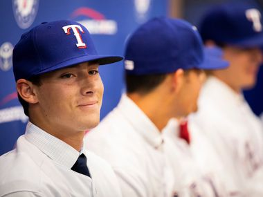 Texas Rangers 1st round pick, pitcher Cole Winn of Orange Lutheran (CA) High School, addresses the media as the Rangers announced the signings of several of the club's draft picks from last week's MLB draft at Globe Life Park on Tuesday, June 12, 2018, in Arlington.