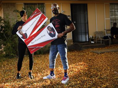 Antanique Johnson and Richard King, who lost their sons Demico and Nico King last month, posed with memorial photos of them outside their Dallas home on Nov. 19, 2020. The two were shot on the same day and died within 10 days of each other.