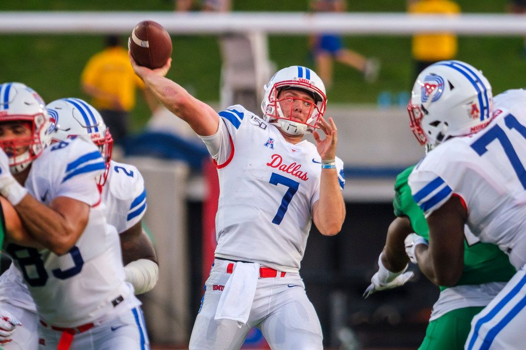 SMU quarterback Shane Buechele (7) throws a 31-yard touchdown pass to wide receiver Reggie Roberson Jr. during the first half of an NCAA football game against UNT at Ford Stadium on Saturday, Sept. 7, 2019, in Dallas. (Smiley N. Pool/The Dallas Morning News)