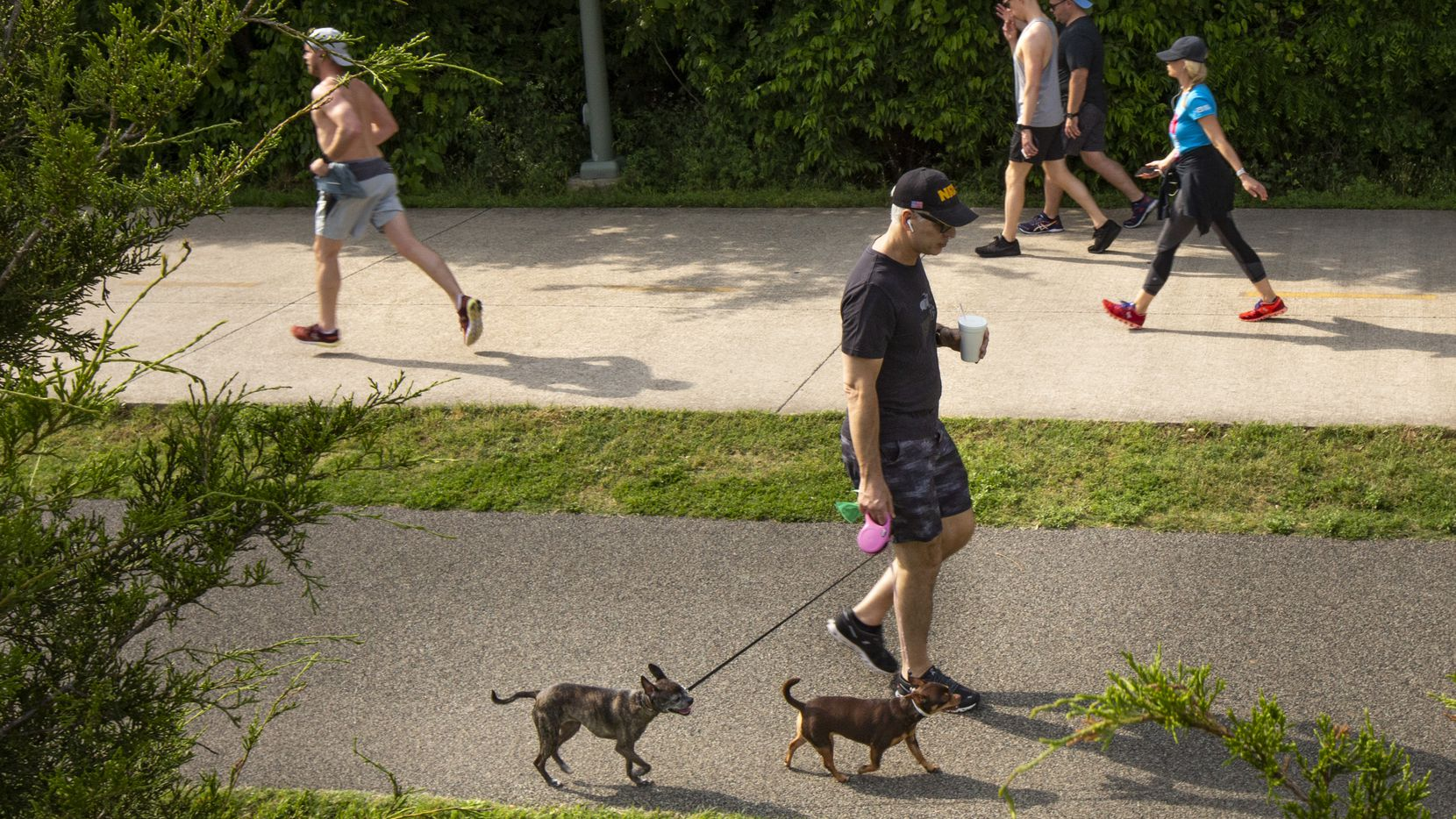Photo of Dallasites run and walk at the Katy Trail in Dallas on Tuesday, April 21, 2020.