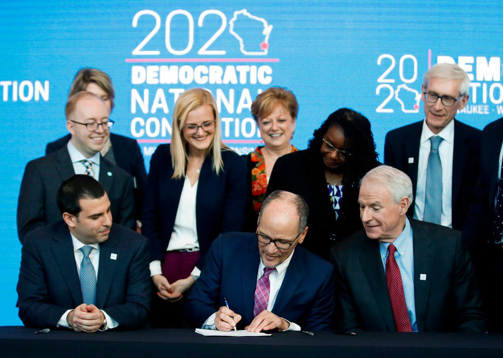 Democrats are postponing their national political convention due to the coronavirus outbreak. In this file photo, Milwaukee Mayor Tom Barrett (bottom R) and Wisconsin Governor Tony Evers look on as Chair of the Democratic National Committee Tom Perez signs a document announcing the selection of Milwaukee as the 2020 Democratic National Convention host city. (Photo by Kamil Krzaczynski / AFP)