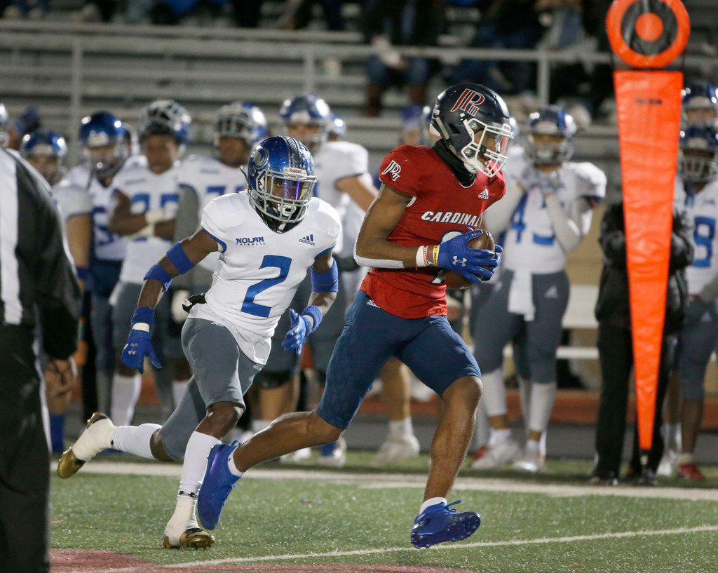 John Paul II Jerand Bradley (9) catches a pass and runs for a touchdown as he is chased by Nolan's Devin Thomas (2) during the first half of their TAPPS Division I second-round high school football playoff game in Grapevine, Tx, Friday, Nov. 22, 2019. (Michael Ainsworth)