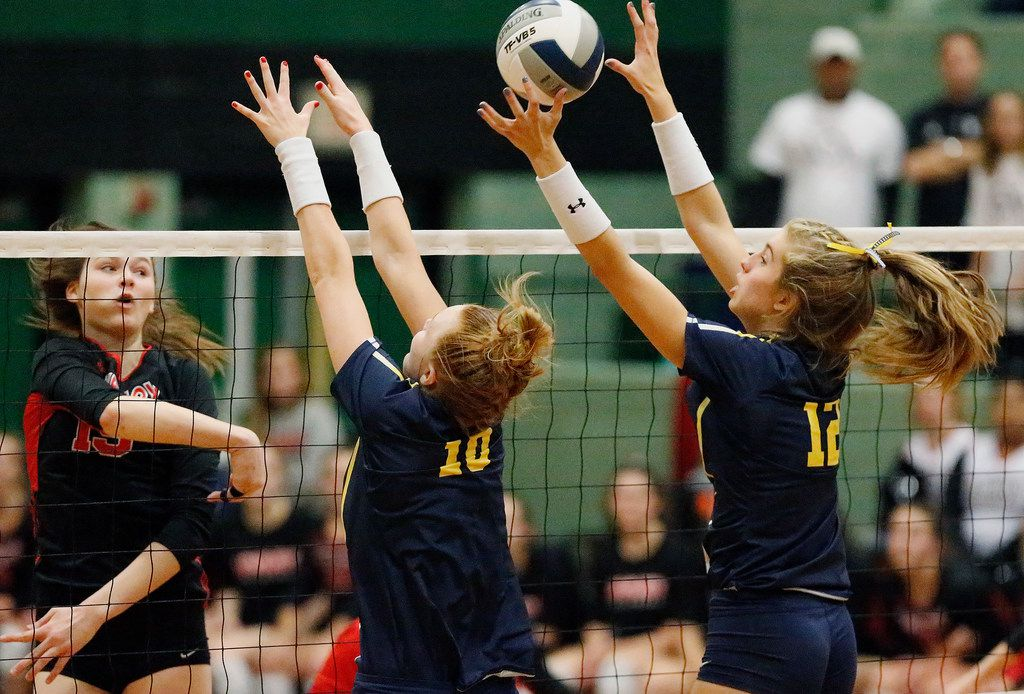 Lovejoy High School middle hitter Lexie Collins (19) attempts to hit while Highland Park High School outside hitter Anna Claire nichol (10) and Highland Park High School middle hitter Lauren Mcmahon (12) go up to block in game one as Lovejoy High School hosted Highland Park High School in the Class 5A Region II championship match held at Berkner High School in Richardson on Saturday, November 16, 2019. (Stewart F. House/Special Contributor)