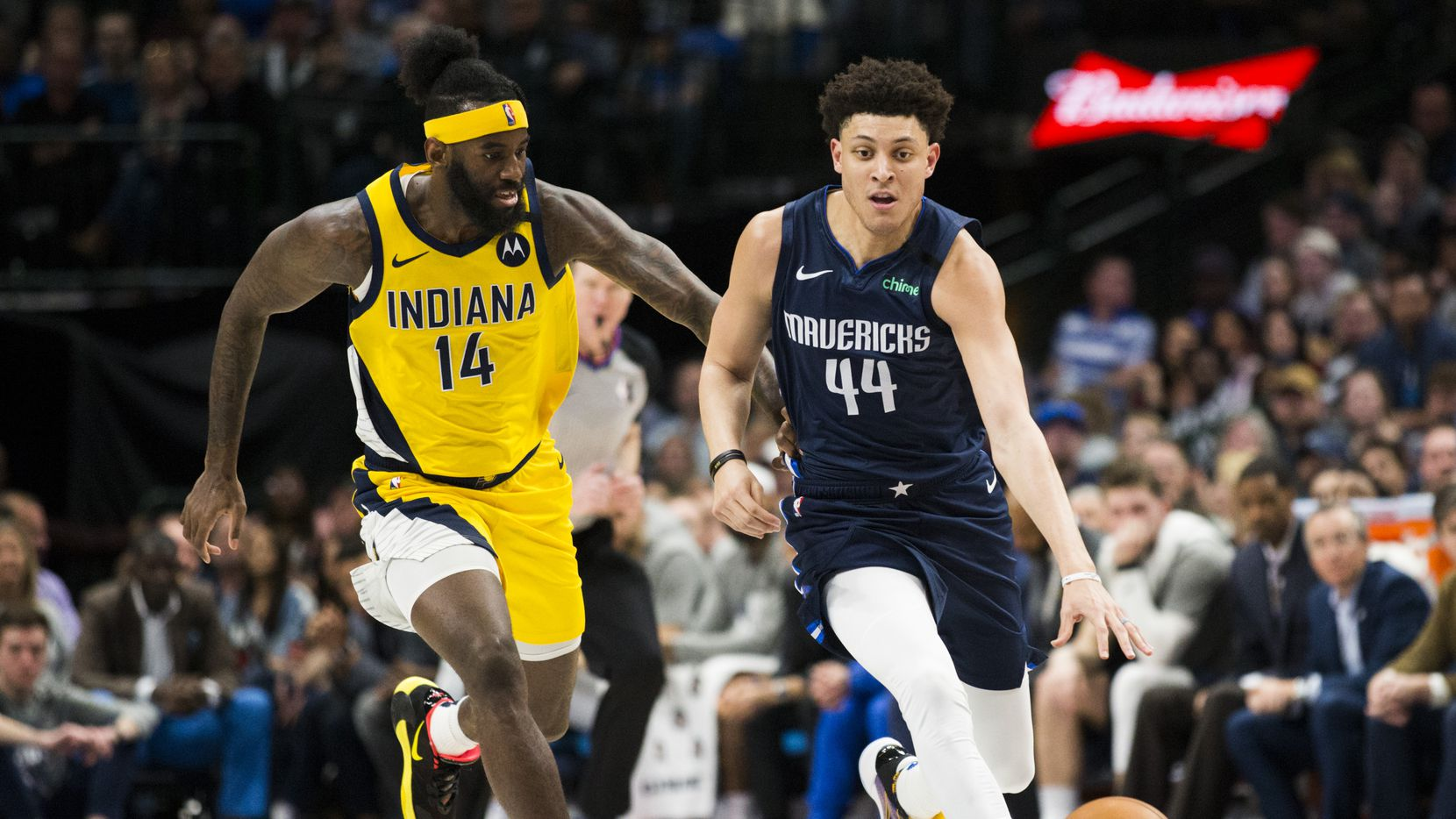 Dallas Mavericks forward Justin Jackson (44) takes the ball down the court ahead of Indiana Pacers forward JaKarr Sampson (14) during the third quarter of an NBA game between the Indiana Pacers and the Dallas Mavericks on Sunday, March 8, 2020 at American Airlines Center in Dallas.