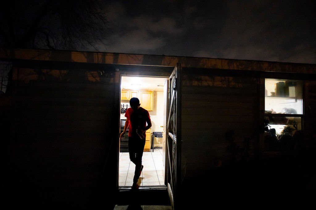 Carlos, a Guatemalan immigrant, walks out of the kitchen door of his home on Feb. 6, 2019, in Dallas.