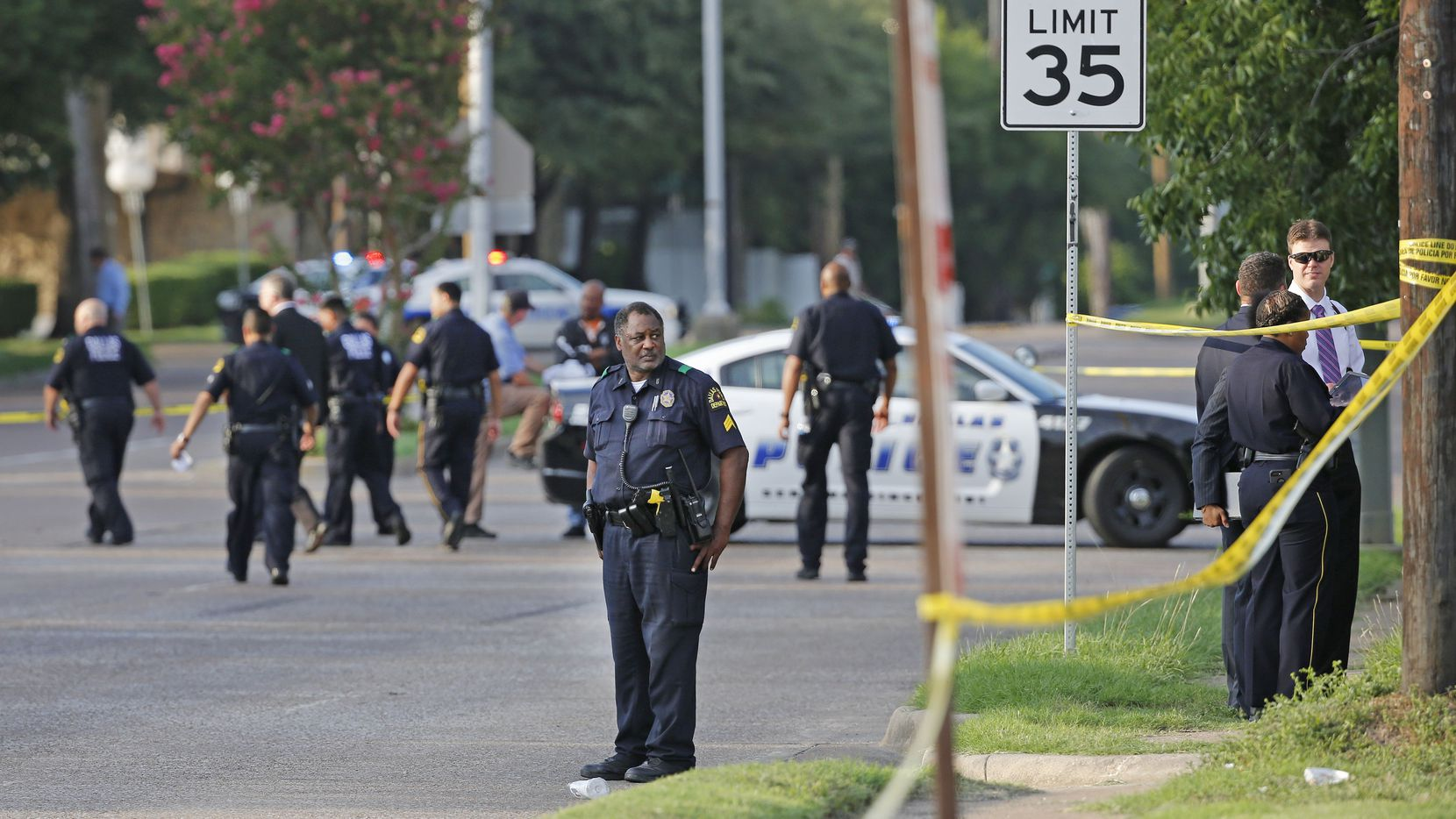 Dallas police investigate an officer-involved shooting near Jim Miller Road and Military Parkway on Friday.