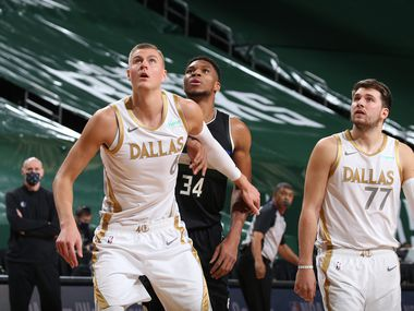 Kristaps Porzingis #6 of the Dallas Mavericks, Giannis Antetokounmpo #34 of the Milwaukee Bucks and Luka Doncic #77 of the Dallas Mavericks fight for position during the game on January 15, 2021 at the Fiserv Forum Center in Milwaukee, Wisconsin.