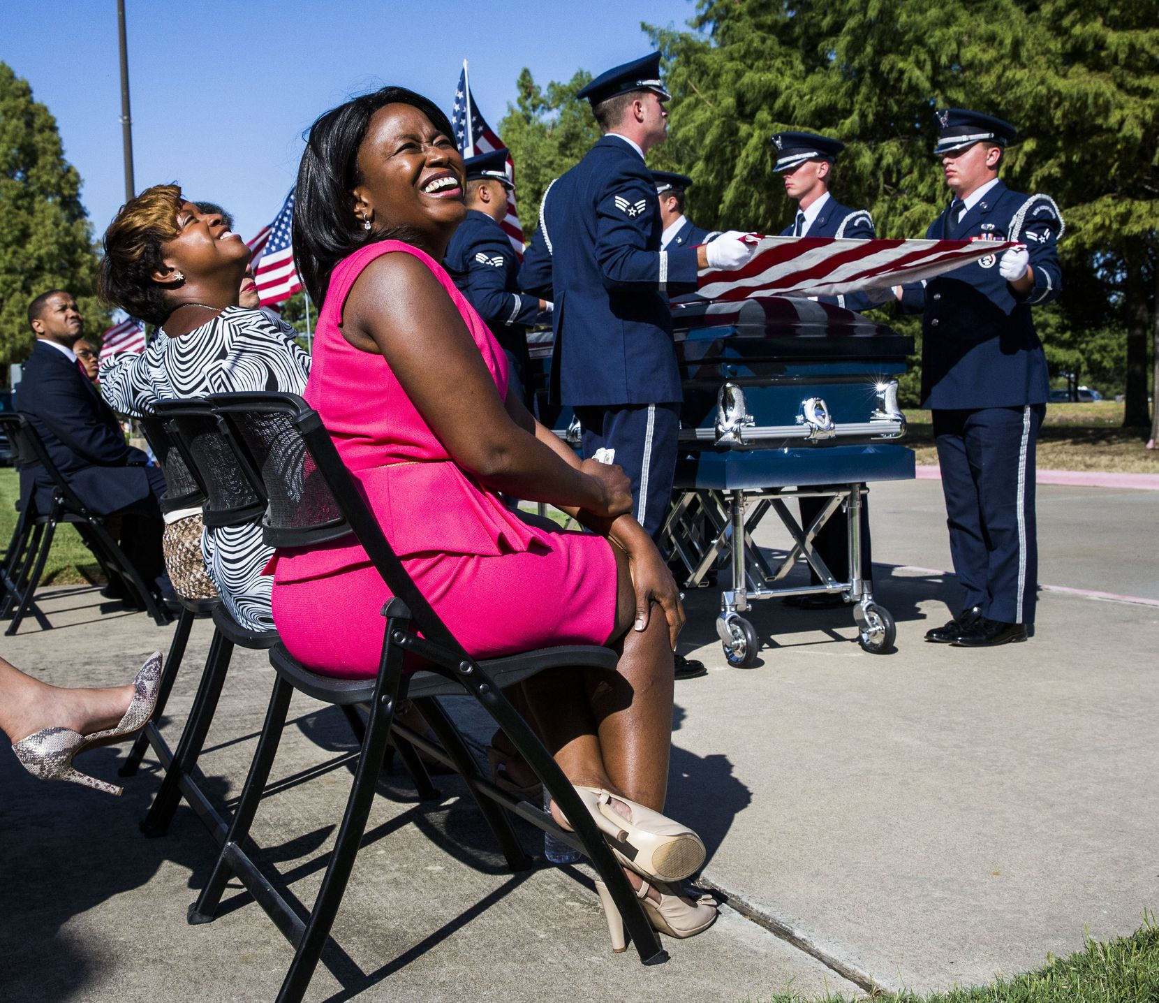 Gai Spann, left, and Dr. Carla Spann Lopez, center, smile as military planes fly overhead during funeral services for their father, retired Army Air Corps 1st Lieutenant Calvin Spann, on Saturday, September 12, 2015 at Covenant Church in Carrollton, Texas.  Spann was an original Tuskegee Airman and fighter pilot with the 100th Fighter Squadron of the 332nd Fighter Group.  He served during World War II, when he flew 26 combat missions. (Ashley Landis/The Dallas Morning News)