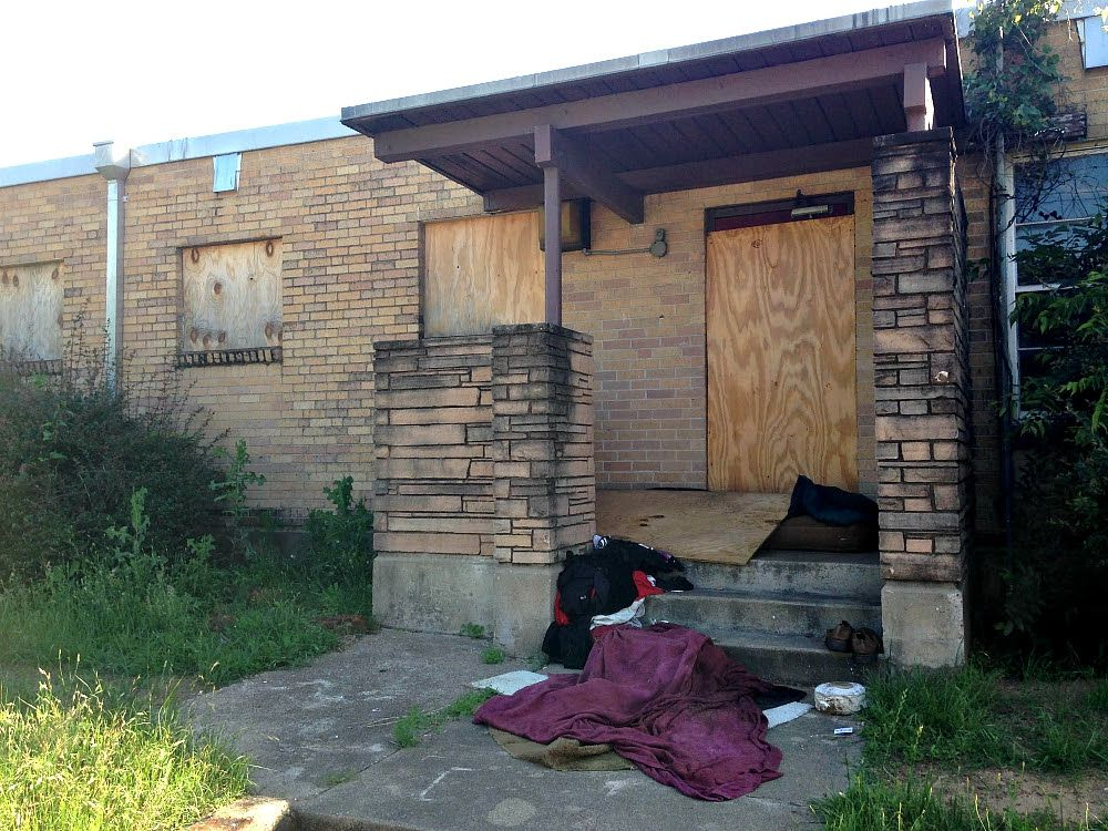 The former home of Station 44 in South Dallas is now a place where homeless people sleep. But soon it could be back in private hands. (Robert Wilonsky/Staff)