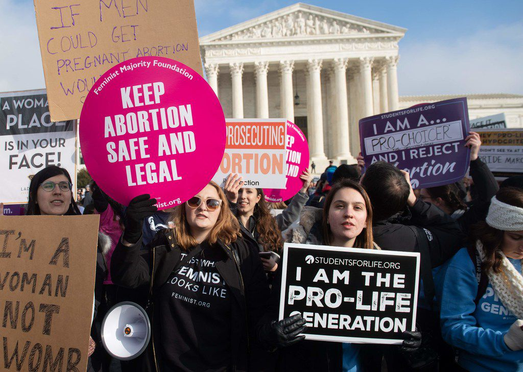 "Abortion rights supporters hold signs alongside abortion opponents participating in the ""March for Life,"" an annual event to mark the anniversary of the 1973 Supreme Court case Roe vs. Wade, which legalized abortion in the US, outside the U.S. Supreme Court in Washington, D.C., on Jan. 18, 2019."