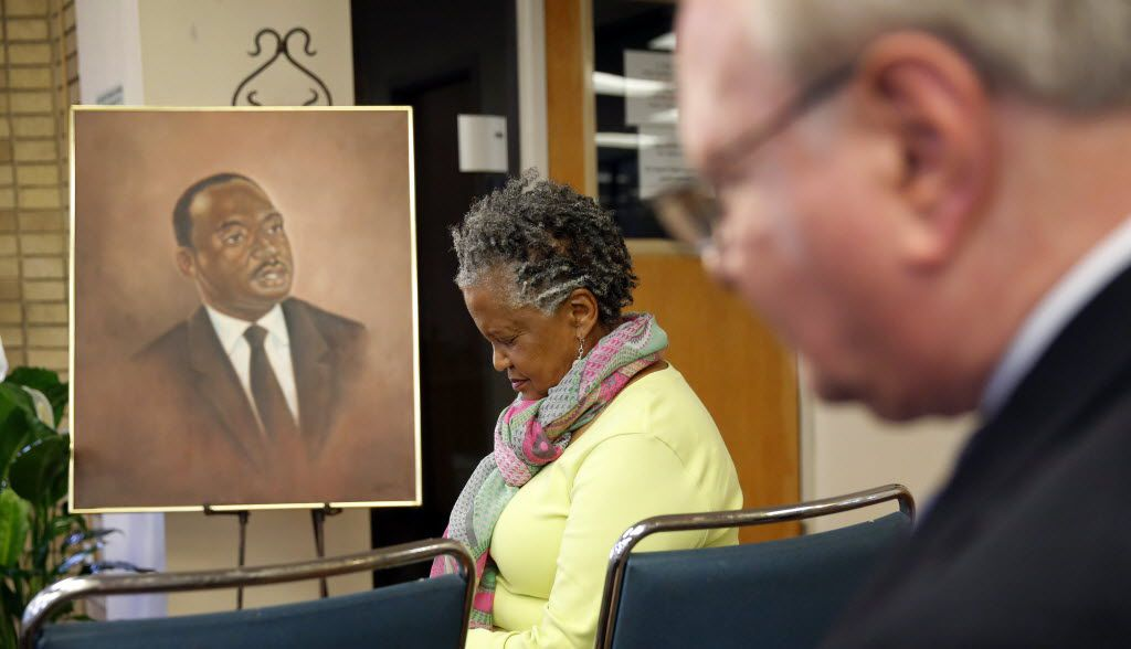 Emma Rodgers of the Dallas Civil Rights Museum prayed at the start of a ceremony to commemorate the 50th anniversary of Dr. Martin Luther King Jr.'s 1966 speech at SMU.  The university presented a bound transcript of his words and a photo of him taken at the event at the Dallas Civil Rights Museum at the Martin Luther King, Jr. Community Center in Dallas.