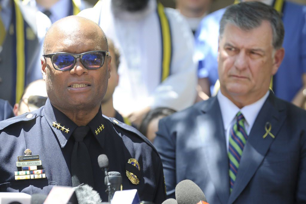Dallas mayor Mike Rawlings listens as Dallas Police Chief David Brown talks during a prayer service at Thanks-Giving Square. (Max Faulkner/Fort Worth Star-Telegram)