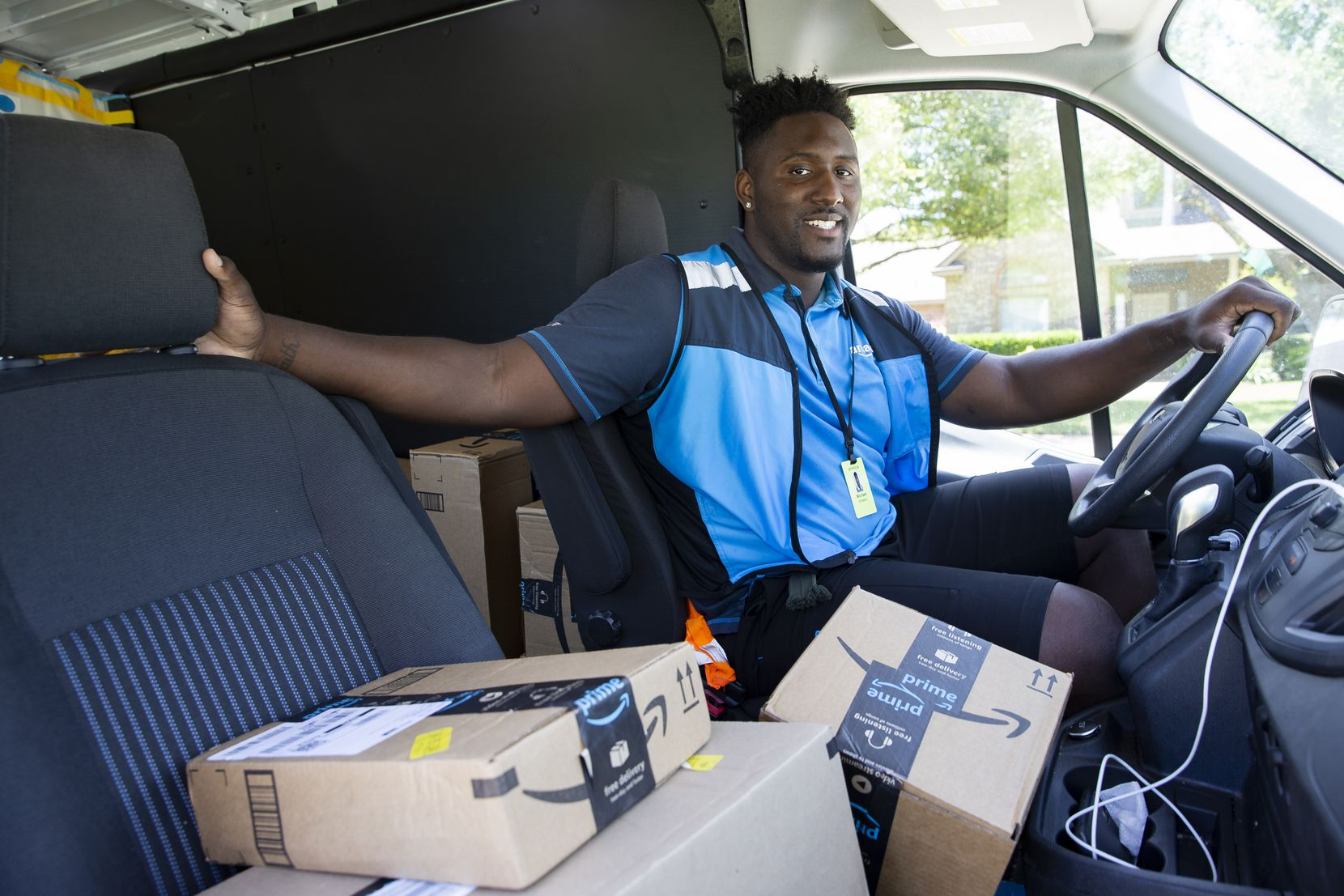 Mike Williams, a SMU defensive tackle, poses for a portrait in between stops on May 29, 2020 in Midlothian. Williams has taken a summer job as an Amazon Prime delivery driver to earn extra money.