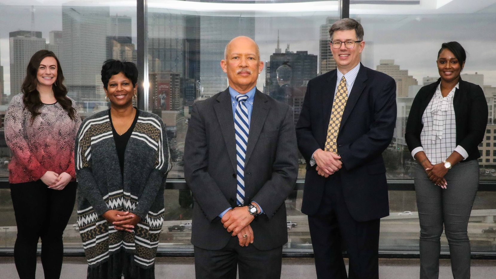 Dallas County District Attorney John Creuzot (center) worked to get care coordinators Carly Turner (from left) and Twana Northcutt, both with the North Texas Behavioral Health Authority, and LaVonda Herring (far right) of Metrocare Services to assist Lee Pierson (right of Creuzot) and his mental health division team. Both prosecutors and defense attorneys are kept up to date on all the care coordinators' clients.