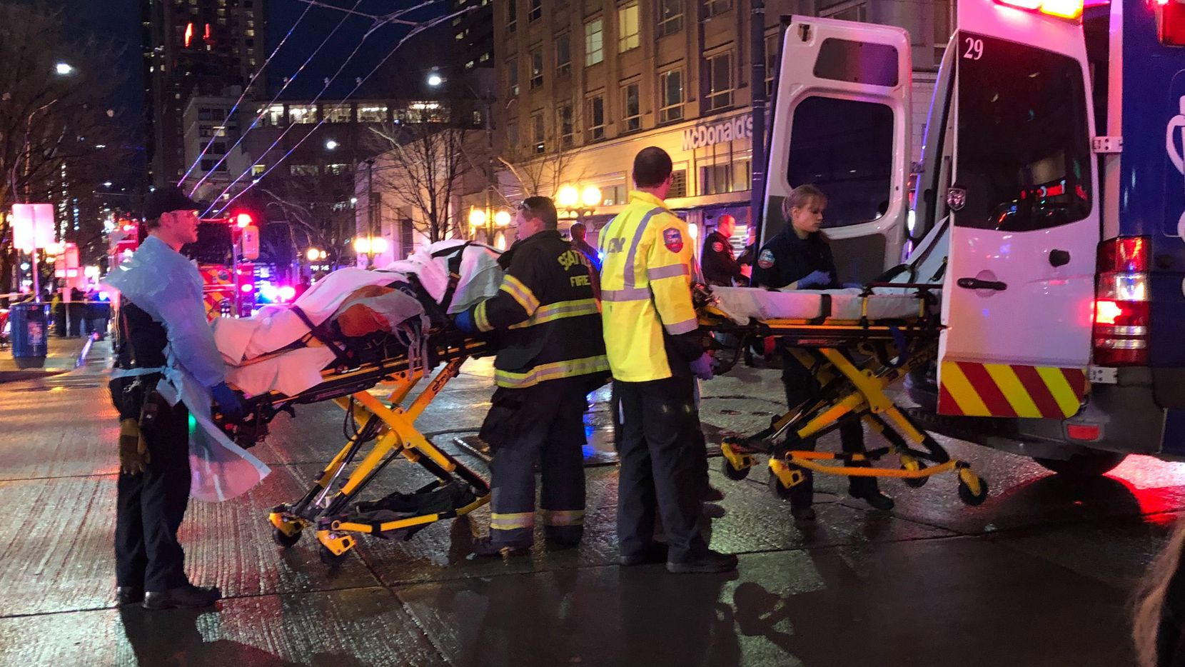 SEATTLE, WA - JANUARY 22: EMT and Police give first aid to a shooting victim in downtown on January 22, 2020 in Seattle, Washington. As many as seven people have been reportedly injured and police are still searching for the suspect. (Photo by Chris Porter/Getty Images)