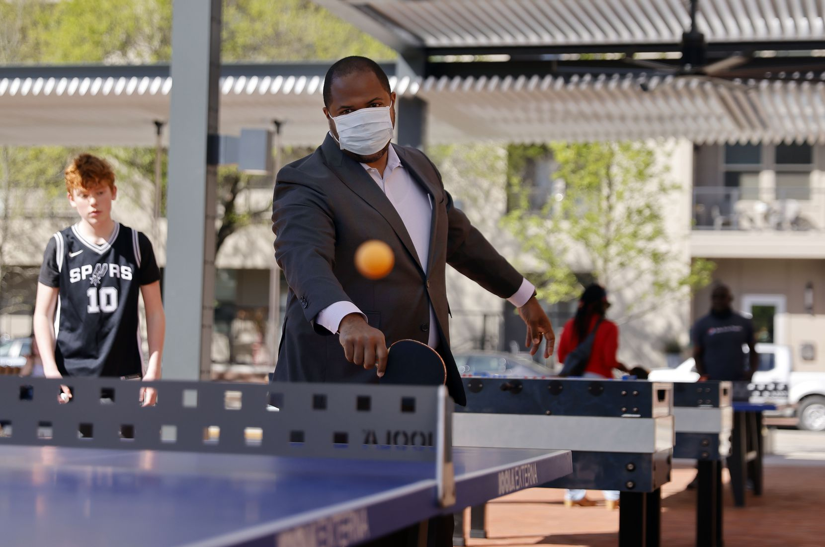 Dallas Mayor Eric Johnson picked up a paddle and got into a competitive match of table tennis after the West End Square ribbon-cutting in downtown Dallas on March 26. The mayor says the lack of face-to-face interaction with Dallas residents has been among the hardest parts of leading through the pandemic.