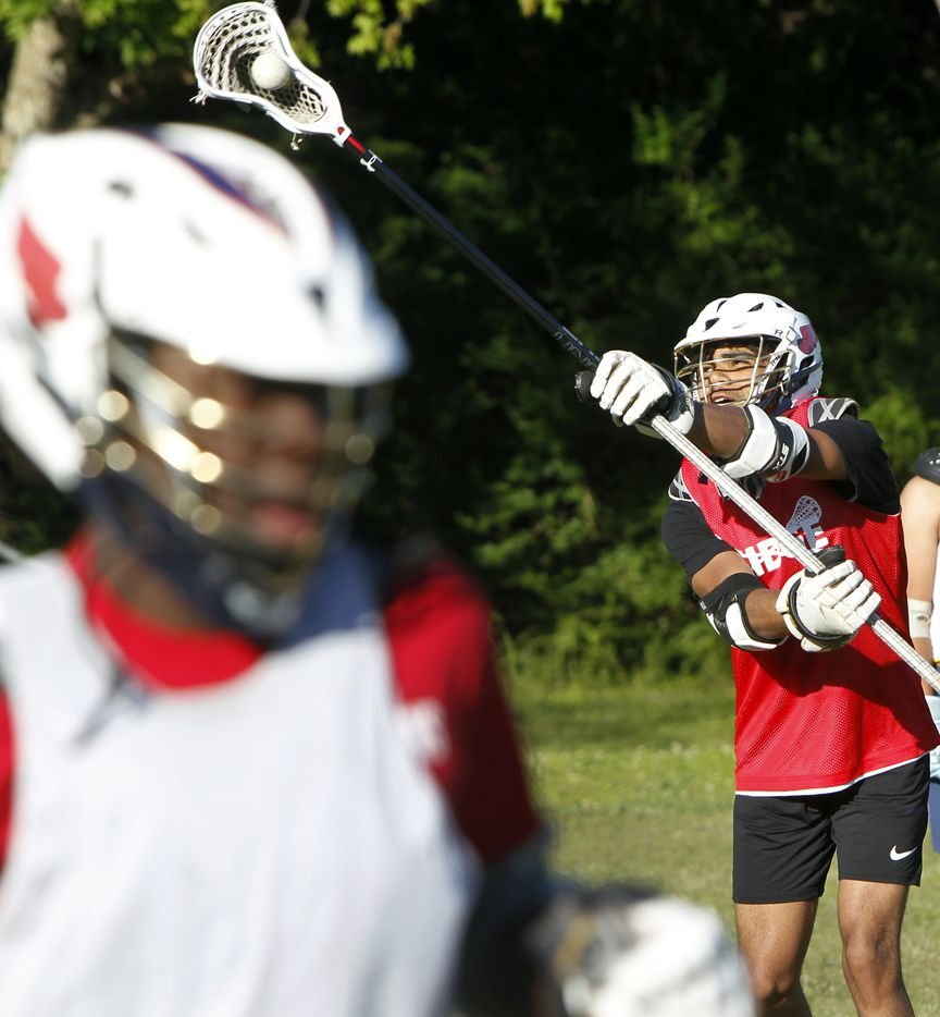 Julian Hayes focuses to make a nice grab during a drill session held by members of the Bridge Eagles lacrosse team. The Bridge lacrosse team held their Wednesday evening practice session at the JC Phelps Recreation Center in Dallas on May 5, 2021.