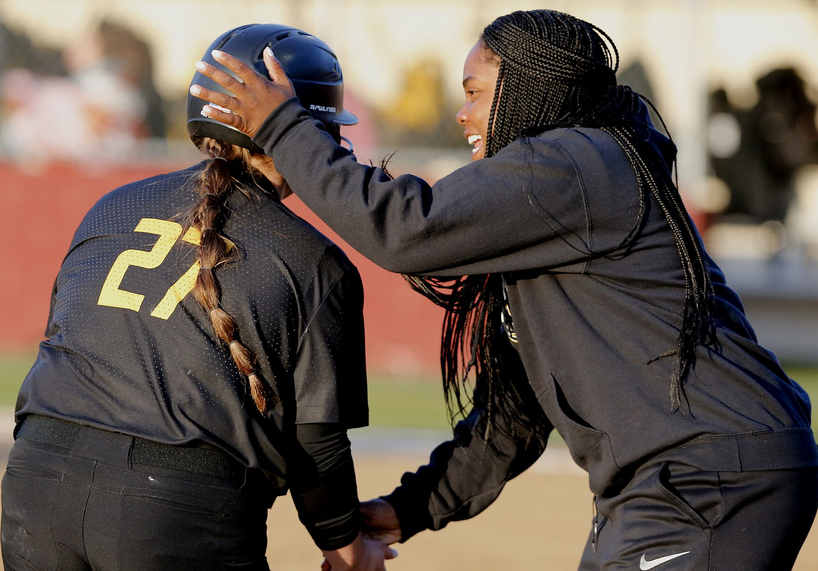 Memorial head coach Porscha Albert congratulates first baseman Peyton Chianese (27) after she hit an over-the-fence home run in the first inning as Heritage High School hosted Memorial High School for the District 9-5A softball championship in Frisco on Tuesday, April 20, 2021. (Stewart F. House/Special Contributor)