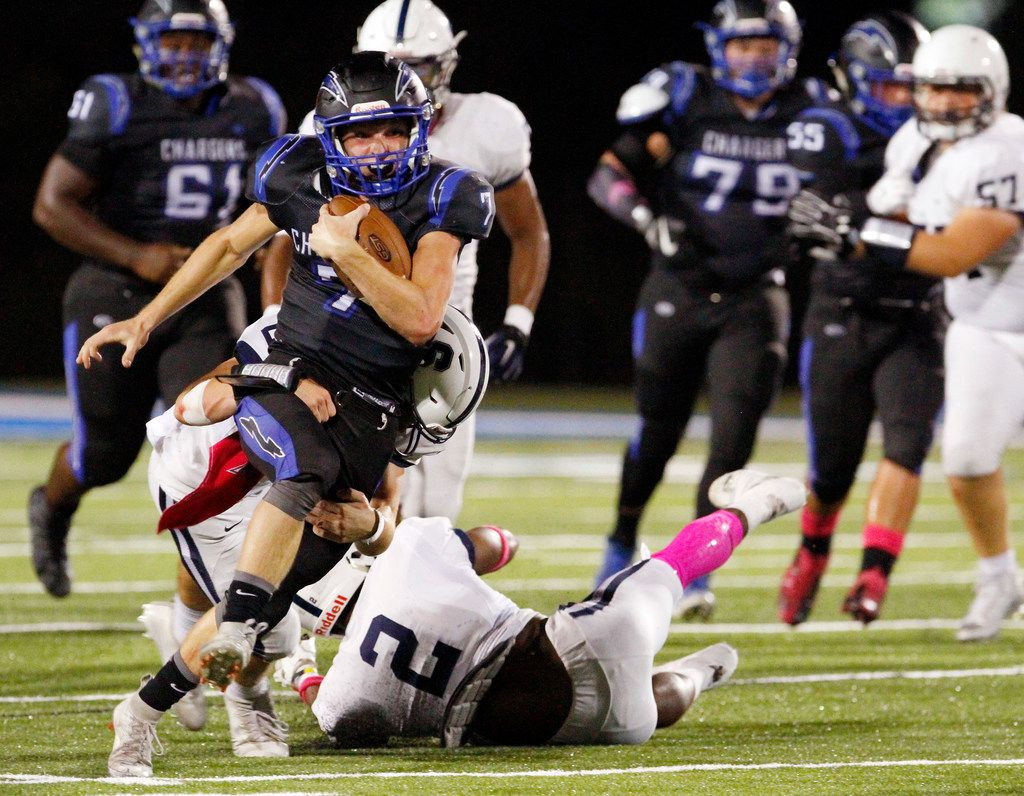 Dallas Christian freshman running back TJ King (7), is tackled on a run by Fort Worth All Saints junior safety Jack Taylor (24) during the first half of a Friday night high school football game at Dallas Christian school in Mesquite, Oct. 06, 2017. Ben Torres/Special Contributor