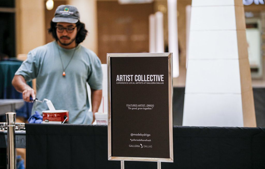 Artist Drigo, Eric Rodriguez, is live painting at Galleria Dallas this week. His art installation is called 'Growing Up.' (Brandon Wade/Special Contributor)